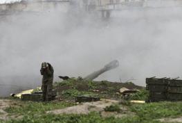 Armenian troops fire artillery towards Azerbaijani fronts.